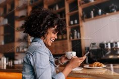 African woman cafe using mobile  by Jacob Lund Photography on @creativemarket