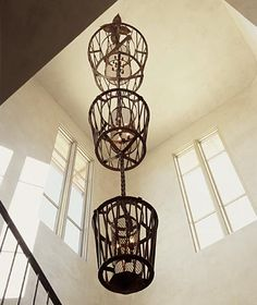 metal baskets for light fixtures...brilliant!  I want to make these for my entry foyer.  by Erin Martin Design.