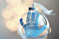Get crafty for your Baby's First Christmas with this adorable hand print ornament! #BRUChristmas