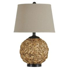 Woven seagrass table lamp.     Product: Table lamp    Construction Material: Seagrass and fabric    Color...