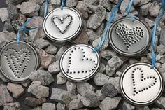 Use a nail and hammer to punch design into can lids. i think i just found my idea for my cub scouts for valentines day for their moms. Tin Can Crafts, Fun Crafts, Crafts For Kids, Arts And Crafts, Recycle Crafts, Upcycle, Country Christmas, Christmas Crafts, Christmas Ornaments