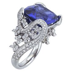 white gold and diamond engagement ring with cushion-cut tanzanite center stone by Mark Patterson