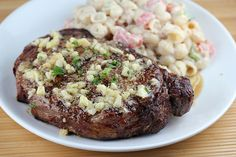 garlic butter steak.  I may try Ruth's Chris Steakhouse Garlic Butter also:  1 lb butter, 3/4 c grated Parmesan cheese,   1 tb ground chervil, 1 tb garlic powder. In a microwave on high power soften the butter but do not allow it to get runny, approximately 40 to 45 seconds. With a wire whip, combine the softened butter, Parmesan cheese, chervil and garlic powder. Blend thoroughly. Texture should be fairly stiff but not runny. Tbs to the steak just before serving.