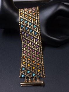 beading This is a Beautiful Beaded Peyote Stained Glass Triangles Bracelet. The dimensions for this bracelet are approximately width x length when using Delica seed beads. Peyote Stitch Patterns, Bead Loom Patterns, Weaving Patterns, Peyote Beading Patterns, Mosaic Patterns, Knitting Patterns, Color Patterns, Crochet Patterns, Bead Loom Bracelets