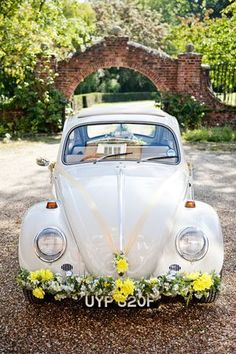 Wedding car with yellow flowers