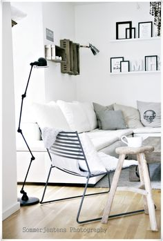 living space: neutral accessories/white walls and sofa