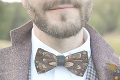 feather boutonniere - photo by Six Hearts Photography http://ruffledblog.com/fall-wedding-ideas-with-a-floral-and-wheat-bouquet