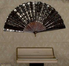 TIFFANY SPANGLED FAN & FAN BOX, 1890-1910  Black silk fan leaf covered w/ various cut-out silver spangles, tortoise sticks & guards studded w/ small silver discs