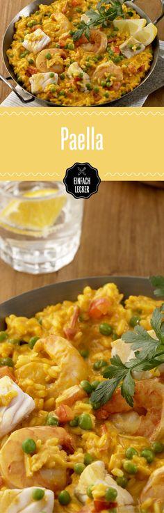 Probier mal Paella - mit Seelachs, Riesengarnelen, Reis, Gemüse und viiielen Gewürzen.