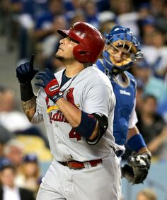 Yadier Molina celebrates his home run next to Los Angeles Dodgers catcher A.J. Ellis during the fourth inning. Cards won 3-1. 6-27-14