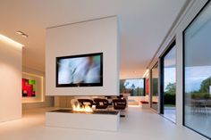 awesome white modern Fireplace Mantels With TV Above in white modern open plan living room design with brown chairs and glass sliding door design ideas of Attractive Fireplace Mantels Designs For Your Luxury Home from Architecture Ideas Tv Stand Modern Design, Tv Stand Designs, Home Fireplace, Fireplace Design, Fireplace Mantels, Houses In Germany, Modern Interior, Interior Design, Modern Tv