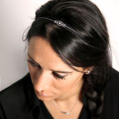 """MUMMY CHOKER/HEADBAND  A particularly elegant, sparkling motif designed by our founder, Audrey, in honor of her Mum! Width 12mm.  Interchangeable as a choker or as a headband; the stretch in the ribbon allows you to adjust for a comfortable, """"stay-put"""" fit. A uniquely adaptable take on the choker trend... wear from the bridal party to the gym!  Made by hand in our Paris atelier with genuine Swarovski® crystals and couture-quality satin ribbon.  Adjustable and water-resistant."""