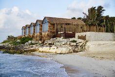 Boutique Hotels Hotels Mexico Tulum sky outdoor body of water house Coast water shore Sea wood Nature real estate cottage Ocean old shack tree rock stone Beach Resorts, Riviera Maya, Cabana, Trippy, Papaya Playa Project, Piscina Do Hotel, Site Archéologique, Jungle Room, Outdoors