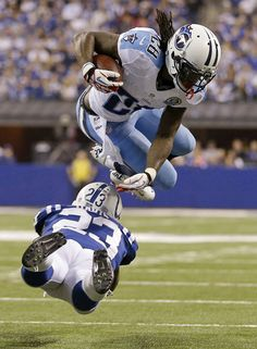 Chris Johnson attempts to avoid a tackle by Indianapolis Colts' Vontae Davis last season (AP Photo/Jeff Roberson). We are looking forward to a great 2013/2014 season. Go Titans!