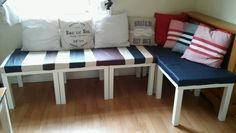 Rhoslyn created this corner seating with Ikea Lack tables, some foam and our scrap leather - wow!        Gloucestershire Resource Centre http://www.grcltd.org/home-resource-centre/