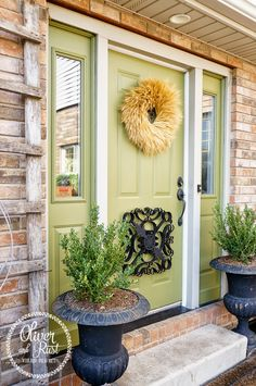 Oliver and Rust || #sherwinwilliams #olivegrove SW 7734 front door with black cast iron urns