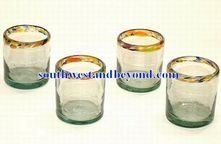 Mexican Bubble Glass - Mexican Glassware Pitcher Sets and Glasses . $18.00. You will love these traditional hand made mexican short drinking glasses made from clear bubble glass and adorned with a beautiful color spotted rim. These will look great in your home either for everyday use or for special occasions. These glasses are sold in a set of four, so the price shown is for four glasses. Due to the hand made nature of our glassware please expect slight variations in size an...