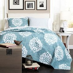 3-Piece Sophie Quilt Set in Blue - Time to Unwind Add a pop of pattern to your master suite or guest room with this lovely quilt set, featuring a damask motif and blue hue.