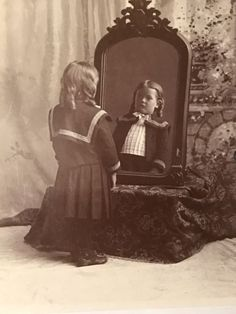 Child-In-Sailor-Outfit-Staring-At-Reflection-In-The-Mirror-With-Rear-View