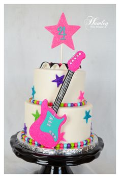 Rock N' Roll - Cute cake for a cute little girl.  The guitar was foam core with fondant overlay...I was afraid it would break or it would've been made out of gum paste.