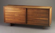 """Expired item, saved for reference. More credenzas on The Mid-Century Modernist »  GEORGE NAKASHIMA walnut cabinet with dovetailed case and two sliding doors with beautifully grained walnut panels on plank legs. Hand marked Duquesne Univ. 32"""" x 72"""" x 20"""""""