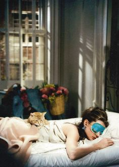 "Audrey Hepburn in ""Breakfast at Tiffany's"" (1961)- this is me and my cat every morning and why i hate getting out of bed reason #204"