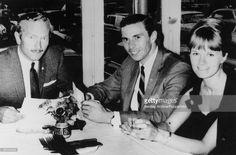 Jim Clark with his girlfriend Sally stokes team boss Colin Chapman(1966)