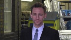 Tom Hiddleston poses for his fans outside ITV Studios on April 11, 2013 gif