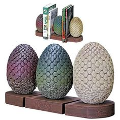 Game Of Thrones - Dragon Egg Bookends are perfect for any fan of the series! Daenerys Targaryen is given three petrified dragon eggs as a gift for her wedding to Khal Drogo. Dark Horse has skillfully