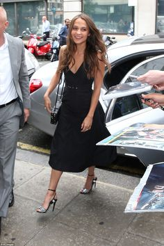 Work  it: Alicia looked gorgeous in a black midi length dress and statement heels as she got busy promoting her new movie Jason Bourne in London on Monday