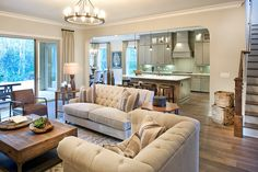 The Vincent model family room and view into the kitchen - a sophisticated style.