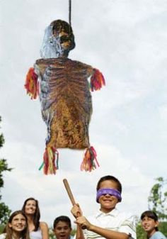 What's better at a children's Halloween party than a zombie pinata? Find other zombie themed ideas here.
