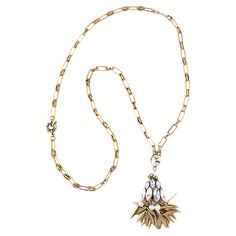 A chic finishing touch for your favorite outfits, this chic necklace features a gold-plated chain and glittering rhinestones with gleaming leaf accents.