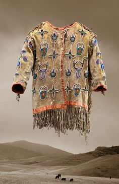 "Child's jacket, ca. 1880, Apsáalooke (Crow), Montana, hide, glass beads; on view in ""Indigenous Beauty: Masterworks of American Indian Art from the Diker Collection,"" at Seattle Art Museum, February 12 – May 17, 2015."