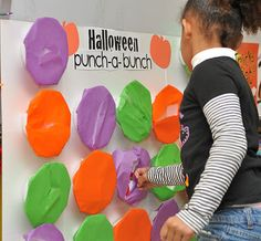 Halloween Punch-A-Bunch...Disposable plates covered in tissue paper with stuff inside. Kids punch through the paper to get the goodies.