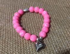 October is Breast cancer Awareness month, show your support this month and all year round with an everyday stretch bracelet. Details  Pink Glass beads