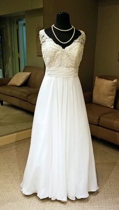 Friday, March 3, 2017 A delicately scalloped illusion V-neckline tops the beaded lace sweetheart bodice of this Christina Wu Love 29271 sleeveless chiffon wedding dress. Illusion straps lead into the lace-up back of this plus size gown. A pleated band accentuates the waistline above the gathered A-line skirt with chapel train. We have this gown …