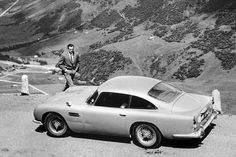 GOLDFINGER ASTON MARTIN When Goldfinger was being made, the was Aston Martin's latest model. A prototype was used in the film, with a second car used for stunts. Aston Martin Db5, James Bond Cars, James Bond Movies, Roger Moore, Der Neue James Bond, American Motors, Sean Connery, Mans World, Sport Cars