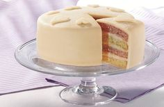 A contemporary twist on the traditional Battenberg cake, this layered almond sponge cake is has a beautiful marzipan finish.