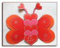a paper butterfly made of hearts glued together :) www.skapligtenkelt.se