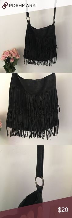 Steve Madden Suede Fringe Purse My fav purse! Worn with love, pictures show slight peeling on the inside straps, price reflect wear. Genuine suede material with silk lining. Steve Madden Bags