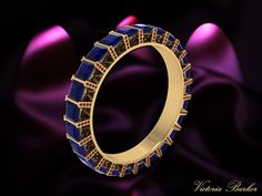 Eternity ring in Sapphire and Ruby  http://www.victoriabarker.london
