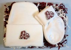Officially Licensed Mississippi State Bulldogs 2 Piece Baby Gift Set includes a soft 100% Cotton newborn knit cap plus a pair of (0/9 month) 100% cotton sock bootees, all decorated with embroidered school logos! Future Tailgater by DHM Kids $14.99