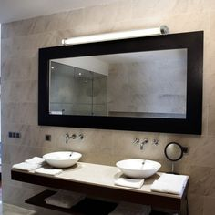 Bathroom Vanity Lights Nz a long fluorescent vanity light mounted on either side gives the