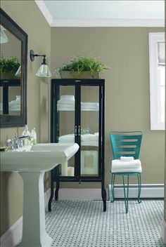 Look at the paint color combination I created with Benjamin Moore. Via @benjamin_moore. Wall: Louisburg Green HC-113; Trim: Marilyn's Dress 2125-60; Chair: Teal Ocean 2049-30.