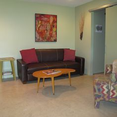 The Cottonwood, artistic room with art from local and area artist. Spacious and open, has tiled shower and an outdoor hot tub.#Hill Country Bed and Breakfast