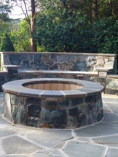 Flagstone Patio With Built In Fire Pit, Seating And Wall With Lighting For  Entertainment