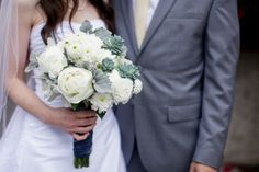 white bridal bouquet with dusty miller accents