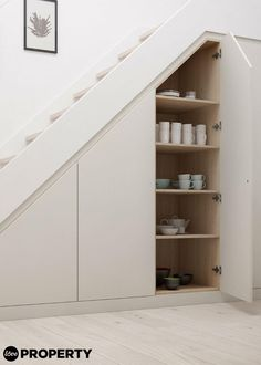 Utilise unused space beneath your staircase by fitting shelving to store your kitchen crockery and plates. Fit cupboard doors for the perfect out-of-sight storage solution. Click for more storage and shelving ideas Image: Daval