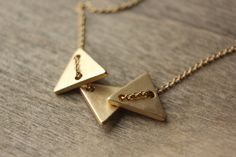 Tri Triangle necklace - Featured on Lucky Magazine online - matte gold - geometric - minimalist - wears multiple ways - gold filled Triangle Necklace, Arrow Necklace, Shes A Keeper, Dainty Gold Jewelry, Lucky Magazine, Geometric Jewelry, Matte Gold, Jackson, Handmade Jewelry